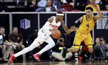 New Mexico's Keith McGee drives while defended by Wyoming's Justin James during the first half of an NCAA college basketball game in the Mountain West Conference tournament, Wednesday, March 13, 2019, in Las Vegas. (AP Photo/Isaac Brekken)