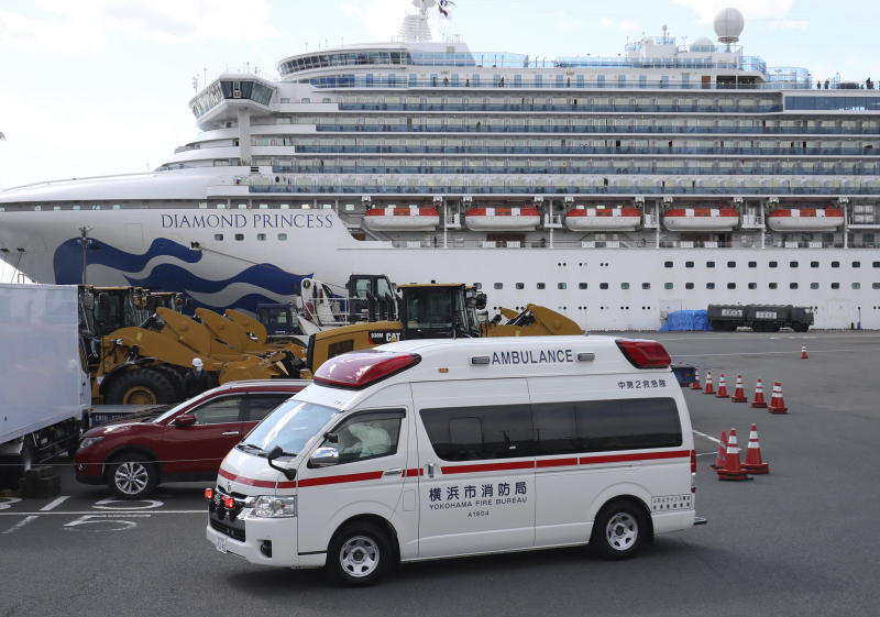 An ambulance leaves Daikoku Futo Wharf where the Diamond Princess anchors in Yokohama, Kanagawa Prefecture on Feb. 18, 2020, amid the outbreak of a new coronavirus in Japan. The virus-hit cruise ship accounted for 454 people who have been infected with the disease as of Feb. 17th.
