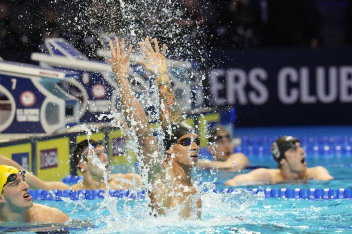 Caeleb Dressel reacts after winning the men's 100 freestyle during wave 2 of the U.S. Olympic Swim Trials on Thursday, June 17, 2021, in Omaha, Neb. (AP Photo/Jeff Roberson)