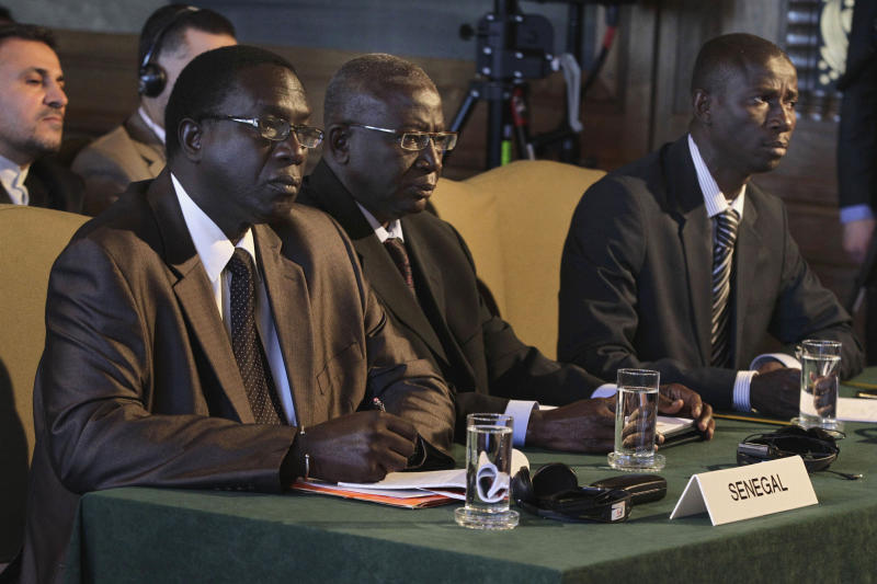 """The delegation of Senegal, left to right; Cheikh Tidiane Thiam, Amadou Kebe and Moustaph Sow, at the International Court of Justice in The Hague, Netherlands, Friday, July 20, 2012. The United Nations' highest court has ordered Senegal to prosecute former Chadian dictator Hissene Habre on torture charges """"without further delay"""" if the country does not extradite him to Belgium. Habre is accused of torturing hundreds of his opponents to death during his 1982-1990 rule in the Central African nation before fleeing to Senegal. (AP Photo/Vincent Jannink)"""