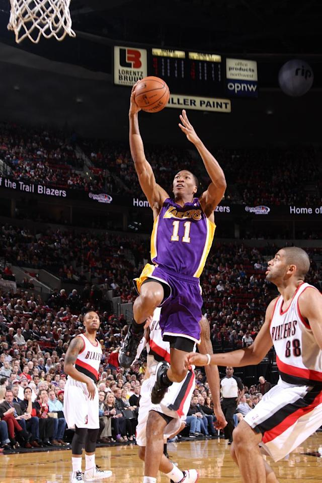 PORTLAND, OR - MARCH 3: Wesley Johnson #11 of the Los Angeles Lakers shoots the ball against the Portland Trailblazers on March 3, 2014 at the Moda Center Arena in Portland, Oregon. (Photo by Sam Forencich/NBAE via Getty Images)