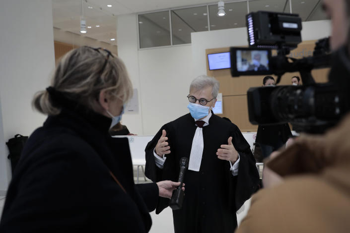 Plaintiffs lawyer Christophe Leguevaques answers reporters before the start of a hearing at the Paris palace of Justice, Wednesday, March 3, 2021. A Paris court holds a hearing Wednesday in a class-action effort to hold French health authorities and companies accountable after thousands of people with the virus died in nursing homes, and families were locked out and left in the dark about what was happening to their isolated loved ones. (AP Photo/Lewis Joly)
