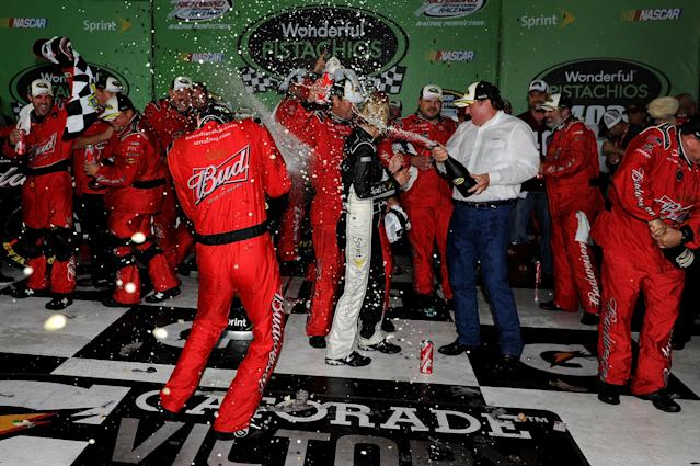 RICHMOND, VA - SEPTEMBER 10: Kevin Harvick, driver of the #29 Budweiser Chevrolet, celebrates in victory lane with his team after winning the NASCAR Sprint Cup Series Wonderful Pistachios 400 at Richmond International Raceway on September 10, 2011 in Richmond, Virginia. (Photo by Patrick Smith/Getty Images for NASCAR)