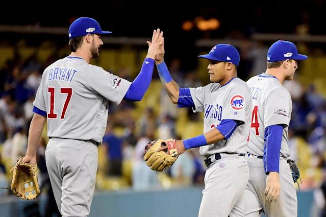 Kris Bryant (L) and Addison Russell of the Chicago Cubs celebrate their 10-2 victory against the Los Angeles Dodgers in game four of the National League Championship Series (AFP Photo/Harry How)