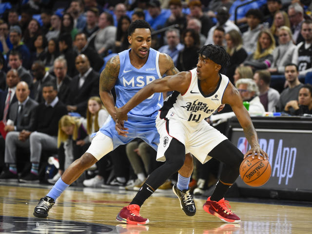 Los Angeles Clippers guard Terance Mann, right, tries to get past Minnesota Timberwolves guard Jeff Teagueduring the first half of an NBA basketball game Friday, Dec. 13, 2019, in Minneapolis. (AP Photo/Craig Lassig)