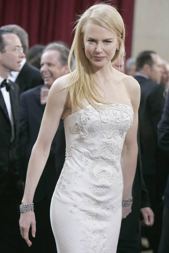 Nicole in a textured strapless gown and diamond bracelets on each wrist at the Oscars