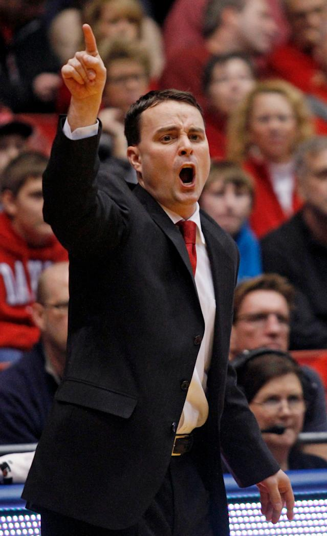 Dayton coach Archie Miller shouts to his team during the first half of an NCAA college basketball game, Sunday, Dec. 22, 2013, in Dayton, Ohio. (AP Photo/Skip Peterson)