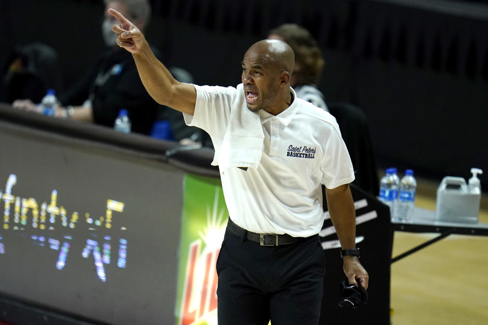 St. Peter's head coach Shaheen Holloway reacts during the first half of an NCAA college basketball game against Maryland, Friday, Dec. 4, 2020, in College Park, Md. (AP Photo/Julio Cortez)