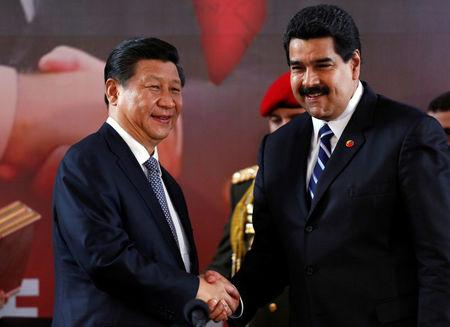 FILE PHOTO: China's President Xi and Venezuela's President Maduro shake hands during a signing ceremony in Caracas