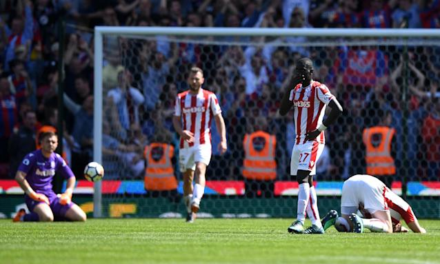 Stoke's players react with despair after Patrick van Aanholt's winner.