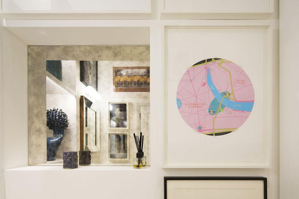 """<p>""""In the downstairs cloakroom, we have hung portraits of our kids in 2008 and had them mounted on a surface mirror. A Michael Craig-Martin and a Christo are also on show, as well as our daughters' ceramics and photographic work.</p>"""