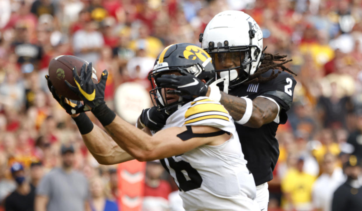 Iowa's Charlie Jones catches a touchdown pass as Iowa State's Datrone Young tries to defend in the second half during an NCAA football game on Saturday, Sept. 11, 2021, in Ames, Iowa. (AP Photo/Justin Hayworth)