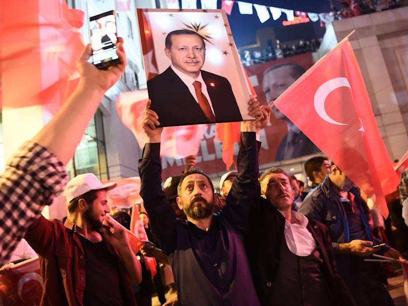 A supporter of the 'Yes' campaign brandishes a picture of Turkish president Recep Tayyip Erdogan: AFP/Getty