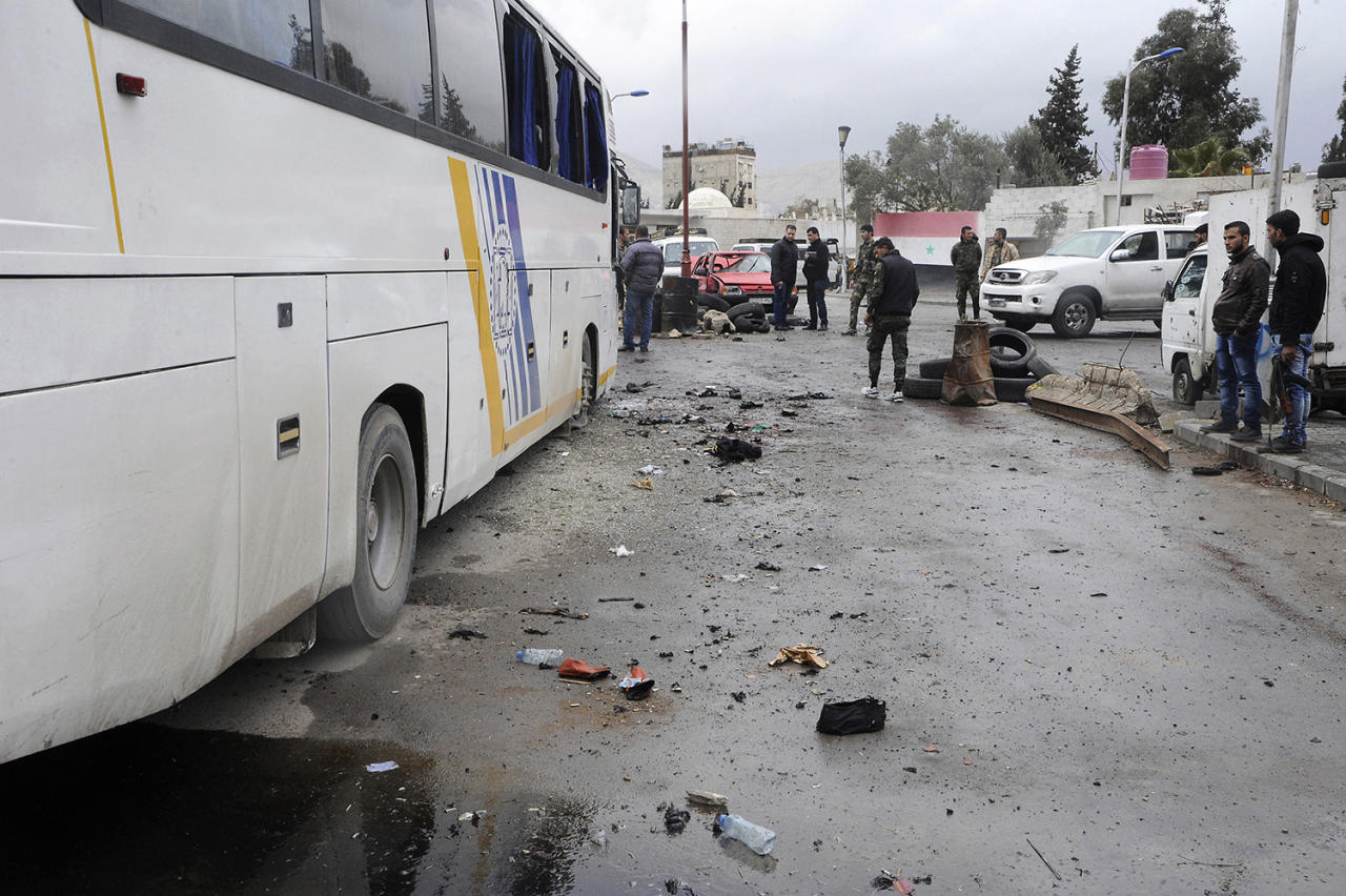 <p>In this photo released by the Syrian official news agency SANA, people inspect damage in a parking lot at the site of an attack by twin explosions in Damascus, Syria, Saturday, March 11, 2017. (SANA via AP) </p>