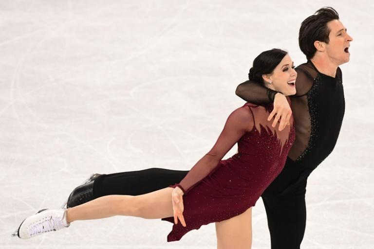 Canada's Tessa Virtue and Scott Moir win the ice dance after a magigal free dance on Tuesday during the Pyeongchang 2018 Winter Olympic Games