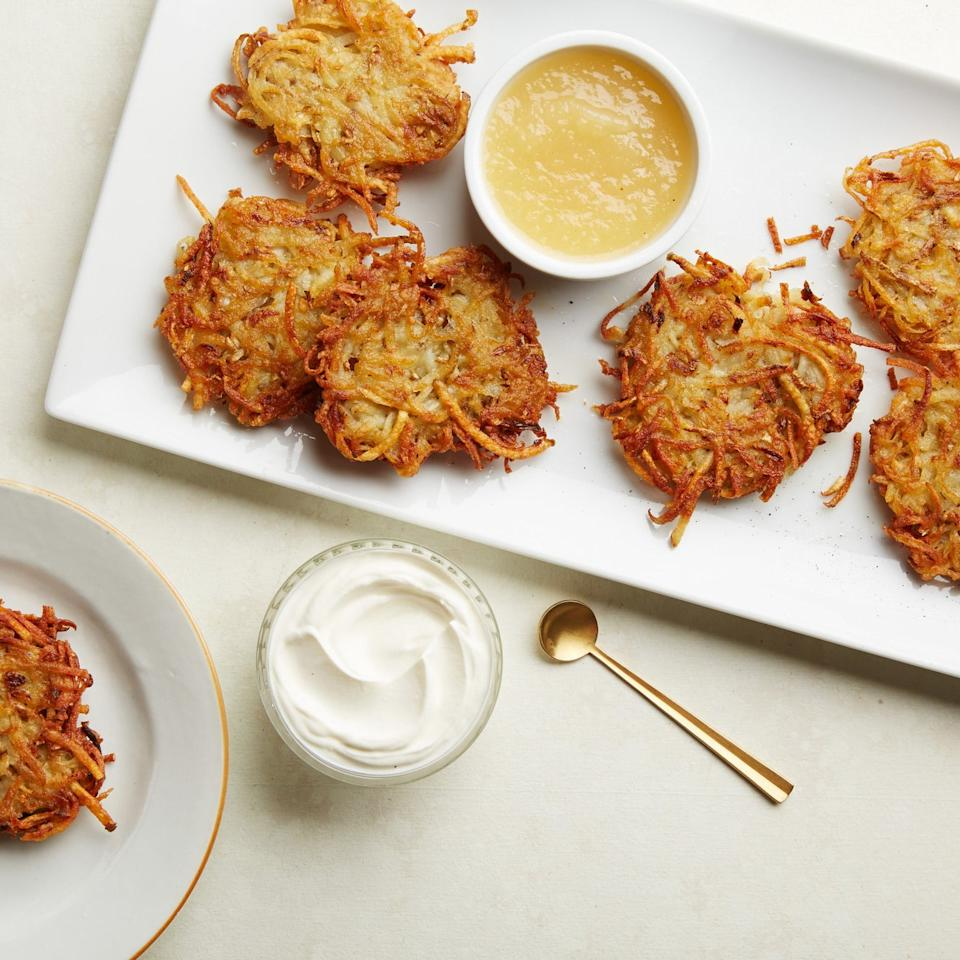 "We fried dozens of latkes—all the highest-rated versions on our site—to come up with our ultimate recipe. This latke recipe gives you potato pancakes with fluffy, pillowy-soft centers and crisp, golden brown edges. Better than Grandma ever made. <a href=""https://www.epicurious.com/recipes/food/views/our-favorite-latkes-51259720?mbid=synd_yahoo_rss"">See recipe.</a>"