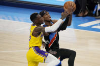 Oklahoma City Thunder guard Shai Gilgeous-Alexander, right, goes to the basket while defended by Los Angeles Lakers guard Dennis Schroeder during the first half of an NBA basketball game Wednesday, Jan. 13, 2021, in Oklahoma City. (AP Photo/Sue Ogrocki)