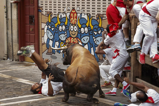 <p>A reveler is gored during the running of the bulls in Pamplona, Spain, July 8, 2016. (Photo: Daniel Ochoa de Olza/AP) </p>