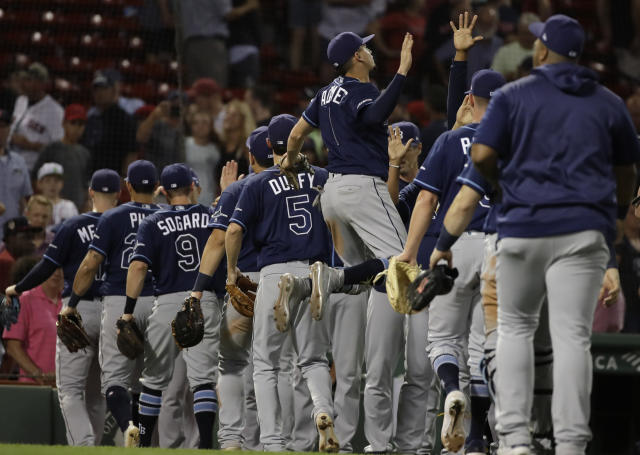 Tampa Bay Rays' Willy Adames (1) jumps to celebrate the team's 9-4 victory over the Boston Red Sox in a baseball game at Fenway Park, Thursday, Aug. 1, 2019, in Boston. (AP Photo/Elise Amendola)