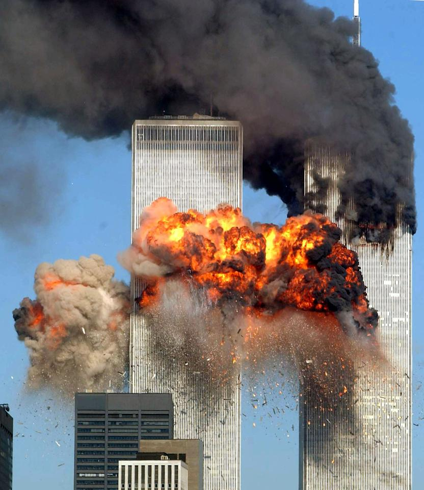 NEW YORK, NY - FILE:   Hijacked United Airlines Flight 175 from Boston crashes into the south tower of the World Trade Center and explodes at 9:03 a.m. on September 11, 2001 in New York City.  U.S. President Barack Obama announced the death of Osama Bin Laden during a late evening statement to the press May 1, 2011 in the East Room of the White House. Bin Laden has reportedly been killed near Islamabad, Pakistan, almost a decade after the terrorist attacks of September 11, 2001 and his body is in possession of the United States.  (Photo by Spencer Platt/Getty Images)