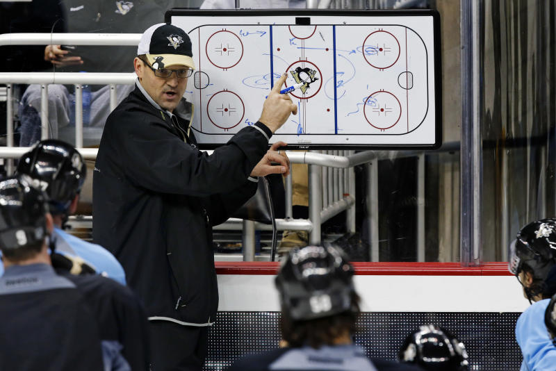 FILE - In this Jan. 14, 2013, file photo, Pittsburgh Penguins head coach Dan Bylsma outlines a drill during an NHL hockey practice at the Consol Energy Center in Pittsburgh. USA Hockey hired Bylsma on Saturday, June 29, 2013, as the coach for the U.S. Olympic men's hockey team at the 2014 games in Sochi, Russia. (AP Photo/Gene J. Puskar, File)