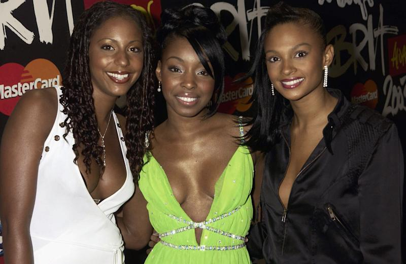 British pop stars Su-Elise Nash, Sabrina Washington and Aleesha Dixon arrive at The Brit Awards 2003 held at Earl's Court Exhibition Centre on February 20, 2003 in London. (Photo by Dave Benett/Getty Images)