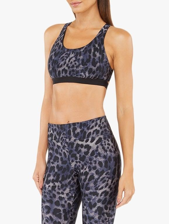 "<p>This <a href=""https://www.popsugar.com/buy/Koral-Tax-Cheetara-Sports-Bra-537789?p_name=Koral%20Tax%20Cheetara%20Sports%20Bra&retailer=bananarepublic.gap.com&pid=537789&price=90&evar1=fit%3Aus&evar9=47080921&evar98=https%3A%2F%2Fwww.popsugar.com%2Fphoto-gallery%2F47080921%2Fimage%2F47080937%2FKoral-Tax-Cheetara-Sports-Bra&list1=shopping%2Cbanana%20republic%2Cworkout%20clothes%2Cactivewear%2Cdesigner%20collaborations%2Ckoral%20activewear&prop13=api&pdata=1"" rel=""nofollow"" data-shoppable-link=""1"" target=""_blank"" class=""ga-track"" data-ga-category=""Related"" data-ga-label=""https://bananarepublic.gap.com/browse/product.do?pid=567447002&amp;pcid=999#pdp-page-content"" data-ga-action=""In-Line Links"">Koral Tax Cheetara Sports Bra</a> ($90) proves animal print is always a good idea.</p>"