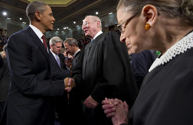 FILE - In this Jan. 24, 2012, file photo President Barack Obama greets Supreme Court Justice Anthony Kennedy and Ruth Bader Ginsburg, right, prior to his State of the Union address in front of a joint session of Congress at the Capitol in Washington. The monumental fight over a health care law that touches all Americans and divides them sharply comes before the Supreme Court Monday, March 26, 2012. (AP Photo/Saul Loeb, Pool, File)