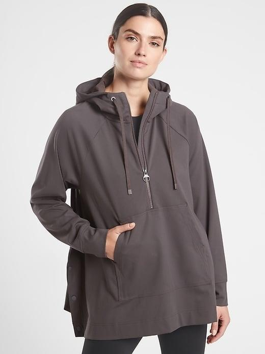 <p>The side buttons on this <span>Athleta Glacier Handkerchief Poncho</span> ($109) make it possible to even layer it on top of another heavy sweatshirt.</p>