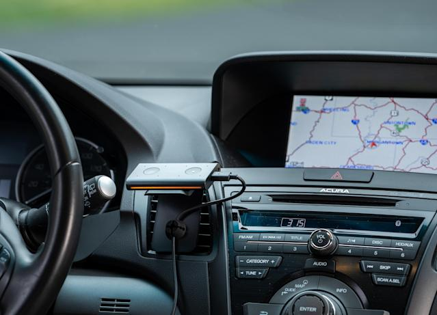 The Echo Auto has an eight-microphone set-up designed to enable it to pick up voice commands. (Getty)