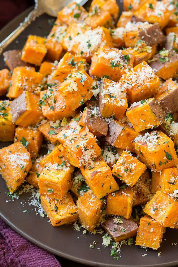 "<strong>Get the <a href=""http://www.cookingclassy.com/2015/09/garlic-herb-roasted-sweet-potatoes-with-parmesan/"" rel=""nofollow noopener"" target=""_blank"" data-ylk=""slk:Garlic-Herb Roasted Sweet Potatoes with Parmesan recipe"" class=""link rapid-noclick-resp"">Garlic-Herb Roasted Sweet Potatoes with Parmesan recipe</a>&nbsp;from Cooking Classy</strong>"