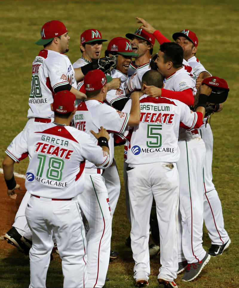 Mexico players celebrate after they winning the Caribbean Series Baseball tournament in Porlamar, Venezuela, Saturday, Feb. 8, 2014. Mexico defeated Puerto Rico 7-1 in the final. (AP Photo/Fernando Llano)