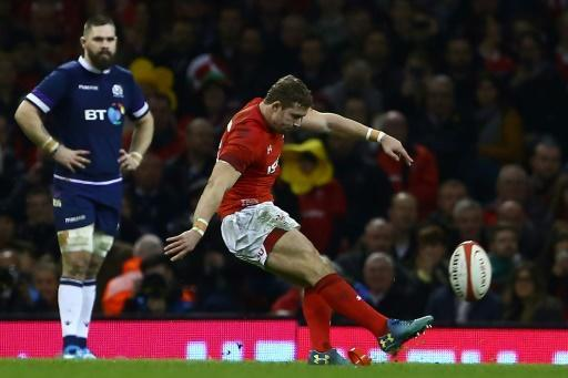 Wales' full-back Leigh Halfpenny (R) kicks a penalty during their Six Nations rugby union match against Scotland, at the Principality Stadium in Cardiff, on February 3, 2018