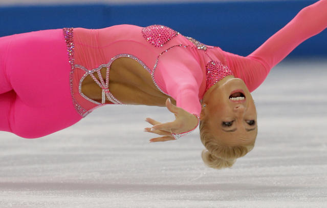Aliona Savchenko and Robin Szolkowy of Germany compete in the pairs short program figure skating competition at the Iceberg Skating Palace during the 2014 Winter Olympics, Tuesday, Feb. 11, 2014, in Sochi, Russia. (AP Photo/Vadim Ghirda)