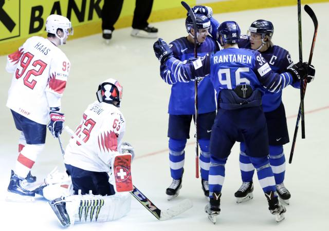 Ice Hockey - 2018 IIHF World Championships - Quarterfinals - Finland v Switzerland - Jyske Bank Boxen - Herning, Denmark - May 17, 2018 - Markus Nutivaara of Finland celebrates with teammates after scoring. REUTERS/David W Cerny