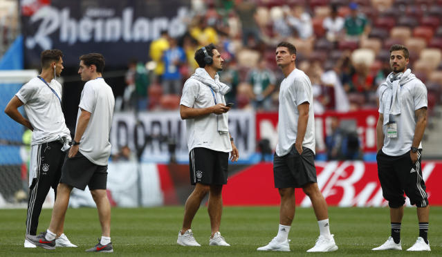 German players chat as tey walkaround the pitch before the group F match between Germany and Mexico at the 2018 soccer World Cup in the Luzhniki Stadium in Moscow, Russia, Sunday, June 17, 2018. (AP Photo/Matthias Schrader)
