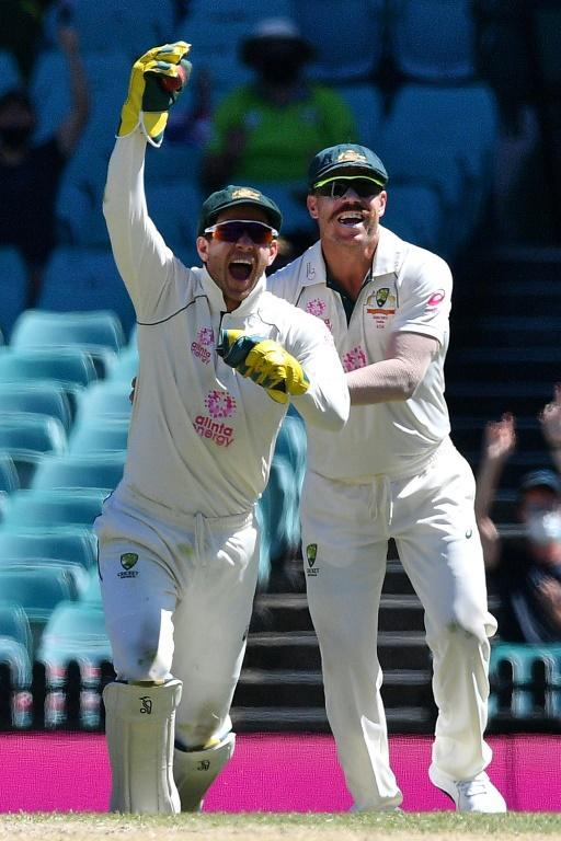 Australia's captain Tim Paine (left) was criticised for his sledging while keeping wicket during the Sydney Test