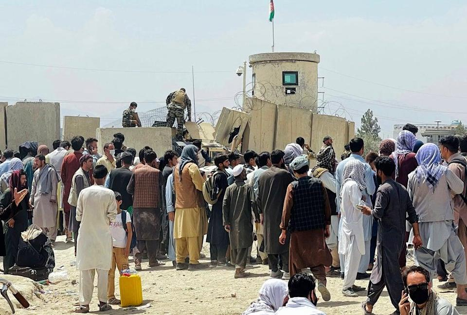 People gather outside the international airport in Kabul, Afghanistan (AP Photo) (AP)