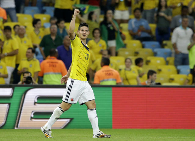 Colombia's James Rodriguez celebrates after scoring his side's second goal during the World Cup round of 16 soccer match between Colombia and Uruguay at the Maracana Stadium in Rio de Janeiro, Brazil, Saturday, June 28, 2014. (AP Photo/Matt Dunham)