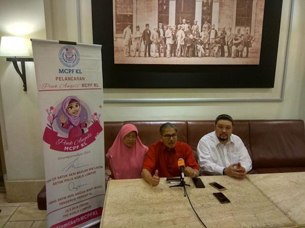 Pink Angels patron and PERKEP KL (Malaysian Police's Wives and Families Association) chairperson Datin Seri Anizah Musa, Mazlan and MCPF KL chairman Bok Siew Mun during the launch today. — Picture by Kenneth Tee