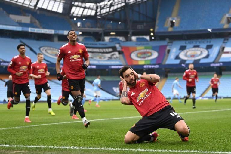 Spot on: Bruno Fernandes's (bottom right)penalty helped Manchester United end Manchester City's 21-game winning run