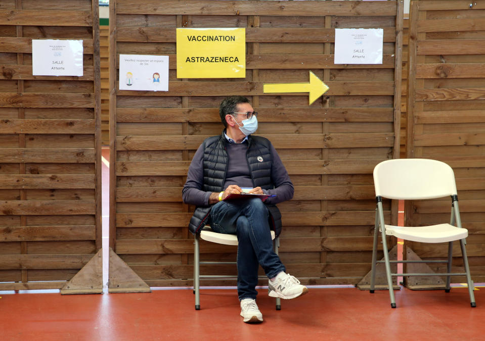 A man waits to get vaccinated with the Astrazeneca COVID19 vaccine in a vaccination center of Saint-Jean-de-Luz, southwestern France, Thursday, April 8, 2021. (AP Photo/Bob Edme)