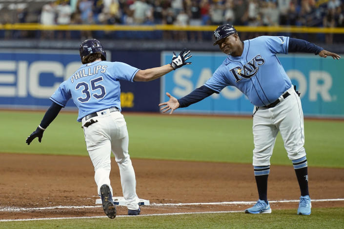 Tampa Bay Rays' Brett Phillips (35) celebrates with first base coach Ozzie Timmons after his grandslam off New York Yankees pitcher Albert Abreu during the sixth inning of a baseball game Thursday, July 29, 2021, in St. Petersburg, Fla. (AP Photo/Chris O'Meara)