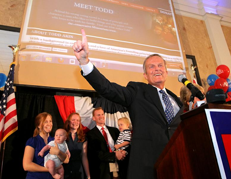 Republican U.S. Senate candidate Todd Akin celebrates his win in the senate primary race at his campaign party at the Columns Banquet Center in St. Charles, Mo., on Tuesday, Aug. 7, 2012. (AP Photo/St. Louis Post-Dispatch, Christian Gooden) EDWARDSVILLE INTELLIGENCER OUT; THE ALTON TELEGRAPH OUT