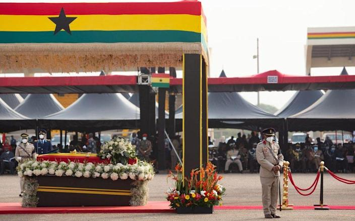 """The casket of former Ghana President Jerry John Rawlings is seen during his final funeral rites in Accra, Ghana, on January 27, 2021. - Former Ghana President Jerry John Rawlings died in November 2020 at the age of 73 and his funeral was initially scheduled for December 23, 2020 but was postponed, due to what the foreign ministry called """"unforeseen circumstances""""."""