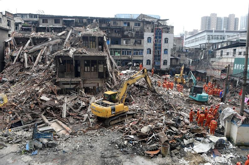 Rescuers searching for survivors at an accident site after four buildings collapsed in Wenzhou, eastern China's Zhejiang province (AFP Photo/)
