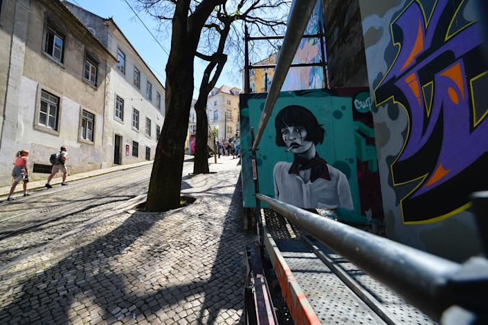 Before the pandemic, Lisbon's historic center was overrun with tourists at the expense of many local residents. (Photo: Artur Widak/NurPhoto via Getty Images)