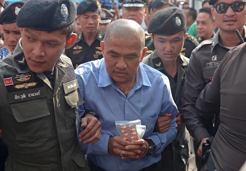 """Thai fortune teller Suriyan Sucharitpolwong, also known as """"Mor Yong"""", faced a military court in Bangkok on October 21, 2015, but has since died in custody (AFP Photo/Pornchai Kittiwongsakul)"""