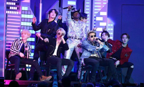 PHOTO: Lil Nas X, background center, and members of BTS perform 'Old Town Road' at the 62nd annual Grammy Awards on Sunday, Jan. 26, 2020, in Los Angeles. (Matt Sayles/Invision/AP Photo)
