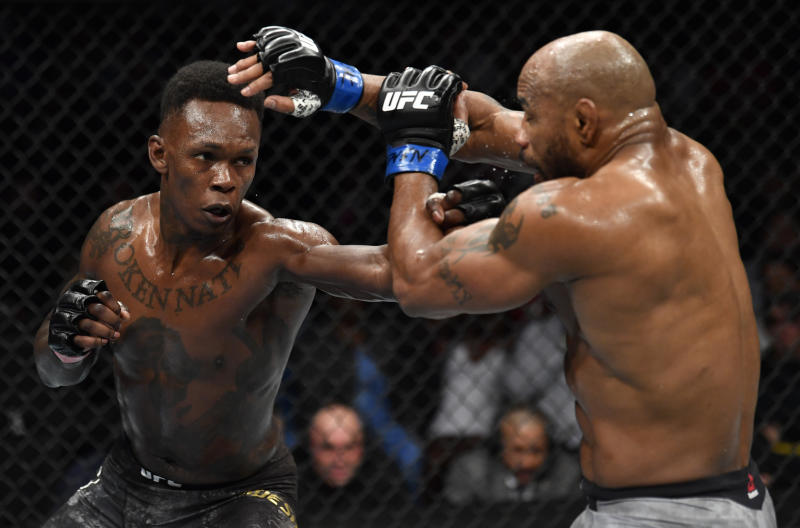 Israel Adesanya of Nigeria punches Yoel Romero of Cuba in their UFC middleweight championship fight during the UFC 248 event at T-Mobile Arena on Saturday in Las Vegas, Nevada.